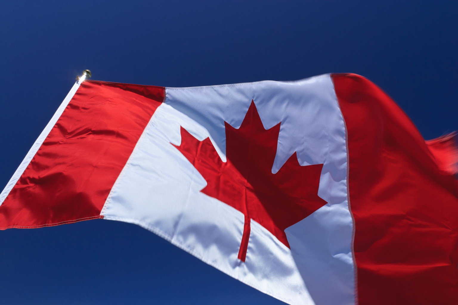 Canadian flag flapping in wind, Vancouver